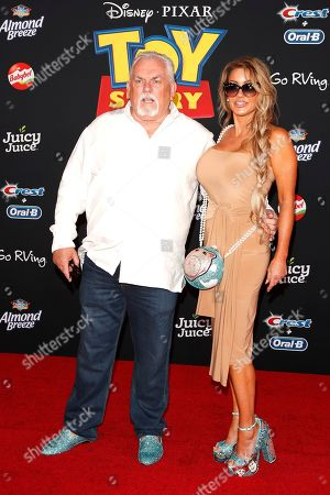 John Ratzenberger and Julie Blichfeldt arrive for the world premiere of 'Toy Story 4' at the El Capitan Theatre in Hollywood, Los Angeles, California, USA, 11 June 2019. The movie opens in the USA on 21 June 2019.