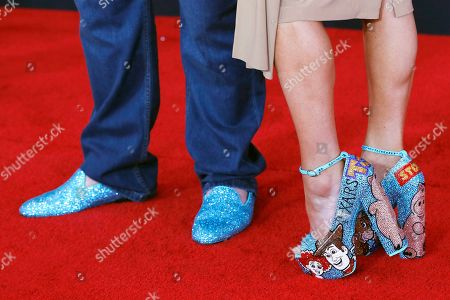 Stock Image of John Ratzenberger and Julie Blichfeldt arrive for the world premiere of 'Toy Story 4' at the El Capitan Theatre in Hollywood, Los Angeles, California, USA, 11 June 2019. The movie opens in the USA on 21 June 2019.
