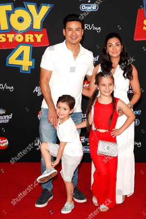 """Mario Lopez, Courtney Lopez, Dominic Lopez and Gia Francesca Lopez arrive for the world premiere of """"Toy Story 4"""" at the El Capitan Theatre in Hollywood, Los Angeles, California, USA 11 June 2019. The movie opens in the US 21 June 2019."""
