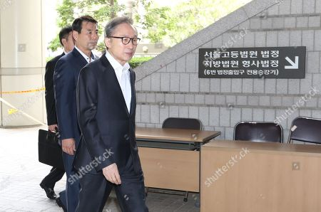 South Korean Former President Lee Myung-bak (front) arrives to attend a hearing at the Seoul High Court in Seoul, South Korea, 12 June 2019. Lee, who was released on bail from a detention center on 06 March, is appealing a 15-year sentence for bribery, embezzlement and other acts of corruption.