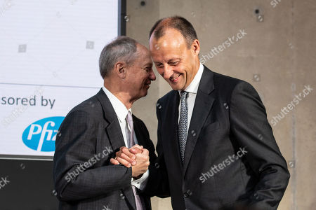 Stock Picture of Chairman of Atlantik-Bruecke e.V. Friedrich Merz (R) shakes hands with the Chairman on American Council of Germany, former US Ambassador John B. Emerson at the 2019 German-American conference in Berlin, Germany, 12 June 2019. The event organized by the Atlantic-Brueke and the American Council on Germany gather under the theme 'Strengthening Transatlantic Resilience in Turbulent Times'. The conference focuses on cyber security, democracy and China relations.