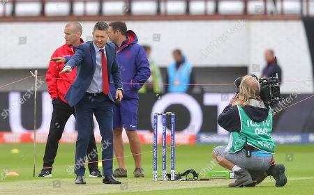 Stock Photo of Former Australia captain Michael Clarke working for TV ahead of the start of play
