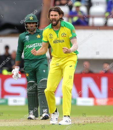 Kane Richardson of Australia celebrates taking the wicket of Asif Ali of Pakistan