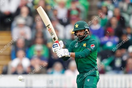 Pakistan's Mohammad Hafeez hits 2 runs off the bowling of Australia's Nathan Coulter-Nile during the Cricket World Cup match between Australia and Pakistan at the County Ground in Taunton, south west England
