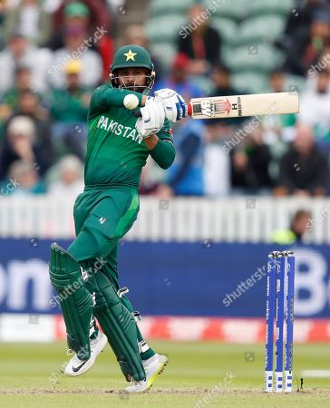 Pakistan's Mohammad Hafeez hits 4 runs off the bowling of Australia's Nathan Coulter-Nile during the Cricket World Cup match between Australia and Pakistan at the County Ground in Taunton, south west England
