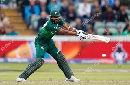 Pakistan's Wahab Riaz plays a shot off the bowling of Australia's Nathan Coulter-Nile during the Cricket World Cup match between Australia and Pakistan at the County Ground in Taunton, south west England
