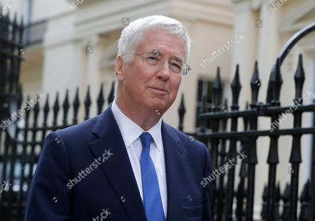 Britain's Conservative Party lawmaker Michael Fallon arrives as Boris Johnson prepares to launch his leadership campaign, in London, . Boris Johnson solidified his front-runner status in the race to become Britain's next prime minister on Tuesday, gaining backing from leading pro-Brexit lawmakers
