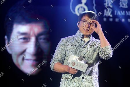 """Hong Kong actor and singer Jackie Chan smiles during a media event announcing his new album """"I AM ME"""" in Taipei, Taiwan"""