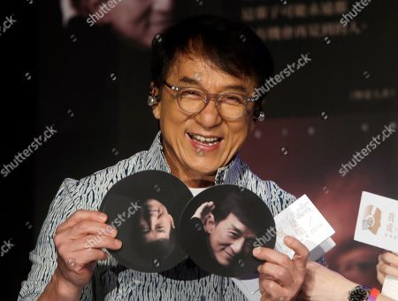 """Hong Kong actor and singer Jackie Chan shows photos during a promotional event announcing his new album """"I AM ME"""" in Taipei, Taiwan"""