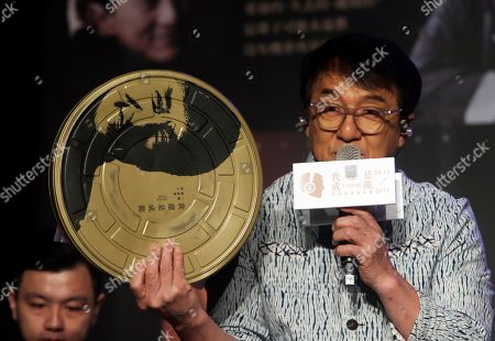 """Hong Kong actor and singer Jackie Chan shows his new album during a media event announcing his new album """"I AM ME"""" in Taipei, Taiwan"""