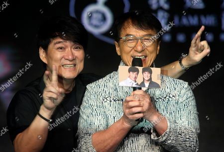"""Jackie Chan, Emil Chau. Hong Kong actor and singer Jackie Chan, right, and Hong Kong singer Emil Chau pose for media during a promotional event announcing Chan's new album """"I AM ME"""" in Taipei, Taiwan"""