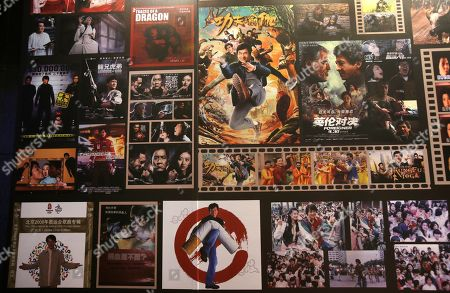 """A collection of the works of Hong Kong actor and singer Jackie Chan's movies are displayed during a media event announcing Chan's new album """"I AM ME"""" in Taipei, Taiwan"""