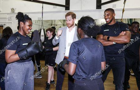 Prince Harry with boxer Anthony Joshua and Nicola Adams