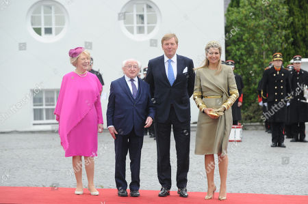 President of Ireland Michael D Higgins (2-L) and Mrs Sabina Higgins (L) greet Their Majesties King Willem-Alexander (2-R) and Queen Maxima (R) of the Netherlands to Aras an Uachtaran in Dublin City, Ireland,  12 June 2019.