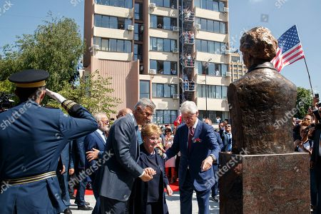 Former US president Bill Clinton (R) and President of the Republic of Kosovo Hashim Thaci (L) accompany Former US Secretary of State Madeleine Albright (C) after unveiling her monument, during the ceremony marking the 20th anniversary of ending the war in Pristina, Kosovo, 12 June 2019. Thousands of Kosovan Albanians gathered on the main square in Pristina to mark the day of 12 June, 20th anniversary when NATO troops entered Kosovo and the war was over. NATO troops enter Kosovo on 12 June 1999, following 78 days air-strikes against Serb security forces to halt widespread ethnic cleansing and killings of Kosovo Albanian civilians.