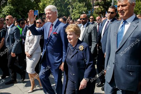 Former US president Bill Clinton (L) joined by former US Secretary of State Madeleine Albright (R) greets Kosovan Albanians during the ceremony marking the 20th anniversary of ending the war in Pristina, Kosovo, 12 June 2019. Thousands of Kosovan Albanians gathered on the main square in Pristina to mark the day of 12 June, 20th anniversary when NATO troops entered Kosovo and the war was over. NATO troops enter Kosovo on 12 June 1999, following 78 days air-strikes against Serb security forces to halt widespread ethnic cleansing and killings of Kosovo Albanian civilians.