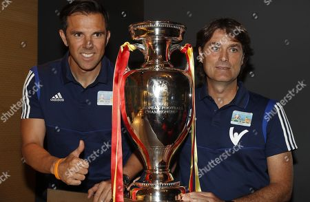 UEFA Euro 2020 Ambassadors Julen Guerrero (R) and Carlos Marchena pose with UEFA Euro 2020 trophy during the presentation of UEFA Euro 2020 host city Bilbao's Organizing Committee, in Bilbao, Spain 12 June 2019. Bilbao is one of the 12 host cities for the UEFA Euro 2020 that will take place from 12 June to 12 July 2020.