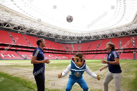 Stock Image of UEFA Euro 2020 Ambassadors Julen Guerrero (R) and Carlos Marchena (L) pose with UEFA Euro 2020 mascot 'Skillzy' during the presentation of UEFA Euro 2020 host city Bilbao's Organizing Committee, in Bilbao, Spain 12 June 2019. Bilbao is one of the 12 host cities for the UEFA Euro 2020 that will take place from 12 June to 12 July 2020.