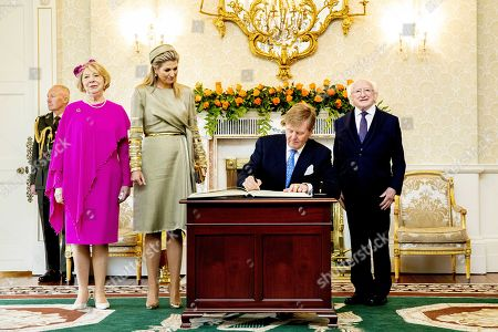 Irish President Michael Higgins and his wife Sabina receive King Willem-Alexander and Queen Maxima at their official residence in Aras an Uachtarain on the first day of the state visit to Ireland, Dublin, 12 June 2019.