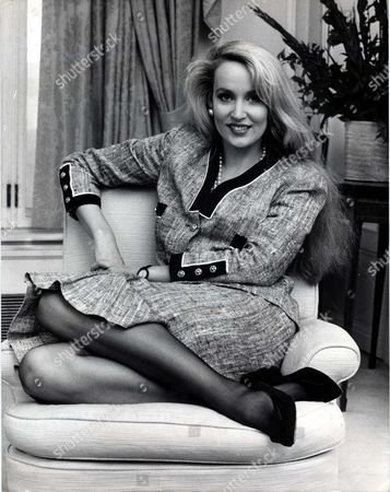Stock Photo of Jerry Hall Fashion Model For Once Jerry Hall Wasnt Drinking Champagne Yesterday. She Was Breast Feeding. 'and' She Drawled 'it Just Might Give Baby James Wind'. Like His Father Mick Jagger James Leroy Augustin Just Four Weeks Old Has A Lusty And Distinctive Yell. It Could Be Heard Clearly In The Next Door Room At The Savoy. Ms Hall Is Staying There With The 18 Month Old Elizabeth Scarlett Too - To Promote Her New Book....fashion Model