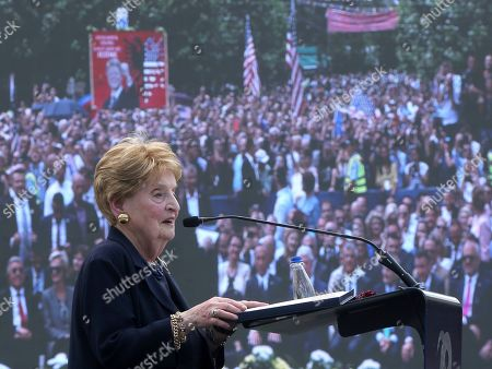 Ex-Secretary of State Madeleine Albright speaks during anniversary celebrations in the capital Pristina, Kosovo, . It's exactly 20 years since NATO forces set foot in the former Yugoslav province, after an allied bombing campaign ended Serbia's bloody crackdown on an insurrection by the majority ethnic Albanian population in Kosovo _ revered by Serbs as their historic and religious heartland