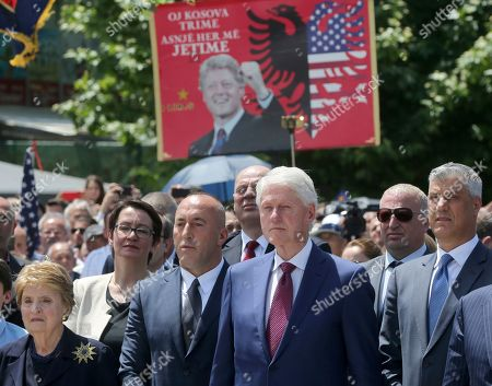 Ex-Secretary of State Madeleine Albright, left, Kosovo's Prime Minister Ramush Haradinaj, second left, former U.S. President Bill Clinton, second right, and Kosovo's President Hashim Thaci attend anniversary celebrations in the capital Pristina, Kosovo, . It's exactly 20 years since NATO forces set foot in the former Yugoslav province, after an allied bombing campaign ended Serbia's bloody crackdown on an insurrection by the majority ethnic Albanian population in Kosovo _ revered by Serbs as their historic and religious heartland
