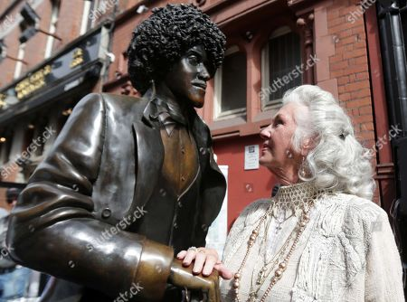 Philomena Lynott admires the newely repaired statue of her late son Phil Lynott in Dublin, Ireland.
