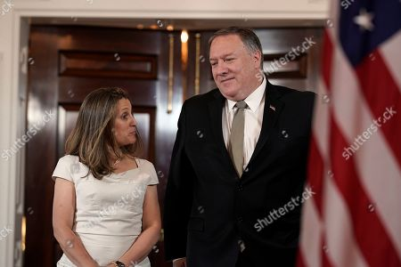 Secretary of State Mike Pompeo, right, arrives with Canadian Foreign Minister Chrystia Freeland, at the Department of State in Washington
