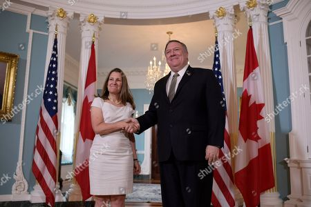 Secretary of State Mike Pompeo, right, shakes hands with Canadian Foreign Minister Chrystia Freeland, at the Department of State in Washington