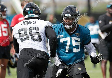 Jawaan Taylor, Datone Jones. Jacksonville Jaguars offensive lineman Jawaan Taylor (75) blocks Jacksonville defensive lineman Datone Jones (96) during a scrimmage at an NFL football practice, in Jacksonville, Fla