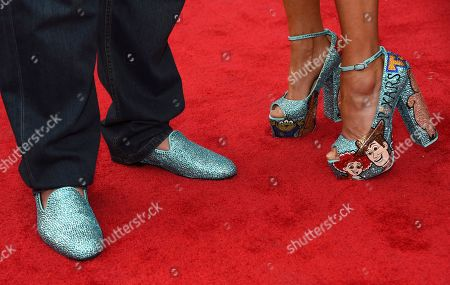 """Stock Photo of John Ratzenberger, Julie Blichfeldt. John Ratzenberger, left, and Julie Blichfeldt arrive at the world premiere of """"Toy Story 4"""", at the El Capitan in Los Angeles"""