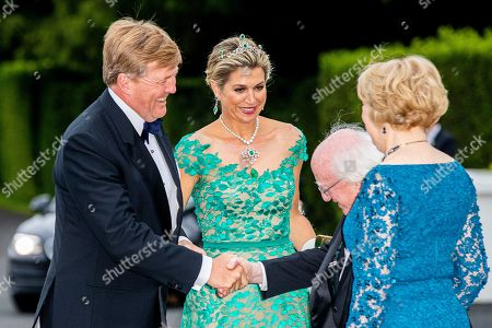 Stock Photo of King Willem-Alexander and Queen Maxima of The Netherlands are welcomed by President Michael Higgins and his wife Sabrina Higgins as they arrive for an official state banquet at the Aras an Uachtarain
