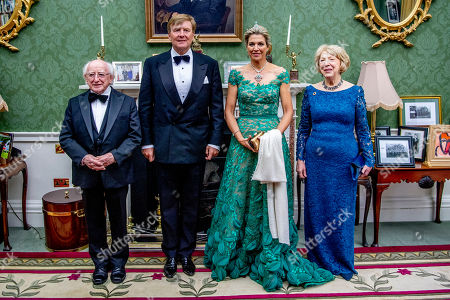 Stock Picture of President Michael Higgins, King Willem-Alexander, Queen Maxima and Sabrina Higgins during an official state banquet at the Aras an Uachtarain
