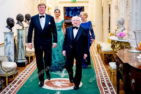 King Willem-Alexander, Queen Maxima, President Michael Higgins and Sabrina Higgins during an official state banquet at the Aras an Uachtarain