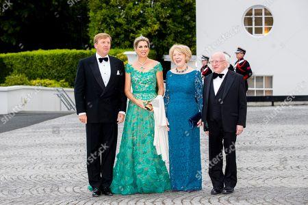 King Willem-Alexander, Queen Maxima, Sabrina Higgins and President Michael Higgins during an official state banquet at the Aras an Uachtarain