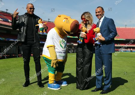From the left, Brazilian singer Leo Santana, the mascot of Copa America 2019 tournament Zizito, Colombian singer Karol G and former Brazilian soccer player Cafu pose during a press conference at Morumbi stadium in Sao Paulo, Brazil, 12 June 2019. The Morumbi stadium will hold the inauguration of Copa America 2019 edition on the upcoming 14 June 2019.