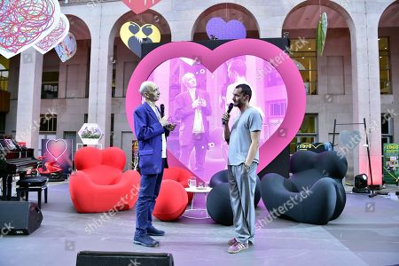 Franco Bolelli and Davide Dileo speaking at the opening of the Festival of Love at the Milan Triennale