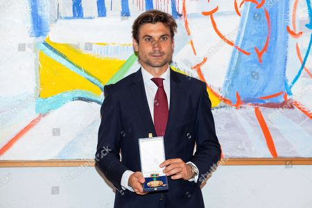 Former Spanish tennis player David Ferrer poses for photographers after receiving the Royal Order of Sports Merit at the Spanish Ministry of Culture and Sports headquarters in Madrid, Spain, 12 June 2019.