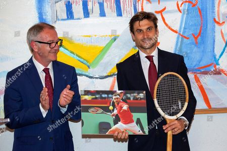 Former Spanish tennis player David Ferrer (R) poses for photographers next to Spanish Minister of Culture and Sports Jose Guirao (L) after receiving the Royal Order of Sports Merit at the Spanish Ministry of Culture and Sports headquarters in Madrid, Spain, 12 June 2019.