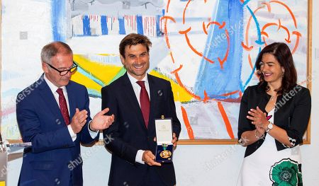 Former Spanish tennis player David Ferrer (C) poses for photographers next to Spanish Minister of Culture and Sports Jose Guirao (L) and Spanish President of the Spanish Superior Sports Council, Maria Jose Rienda (R) after receiving the Royal Order of Sports Merit at the Spanish Ministry of Culture and Sports headquarters in Madrid, Spain, 12 June 2019.