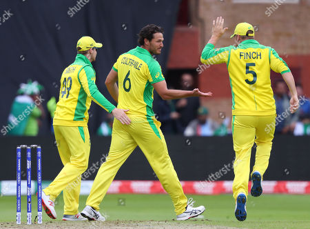 TAUNTON, ENGLAND. 12 JUNE Nathan Coulter-Nile celebrates with captain Aaron Finch of Australia after taking the wicket of Babar Azam of Pakistan during the Australia v Pakistan, ICC Cricket World Cup match. at the County Ground, Taunton