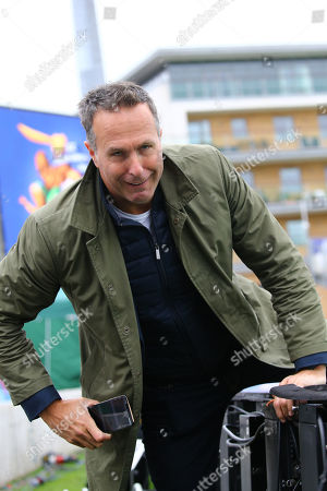 TAUNTON, ENGLAND. 12 JUNE Former England cricket team captain and broadcaster Michael Vaughan struggles over the advertising boards during the Australia v Pakistan, ICC Cricket World Cup match. at the County Ground, Taunton
