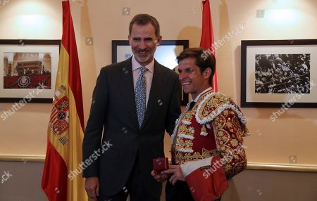 Spanish King Felipe VI (L) greets Spanish bullfighter Julian Lopez 'El Juli' (R) after attending the traditional Charity Bullfight held at the Las Ventas Bullring in Madrid, Spain, 12 June 2019.