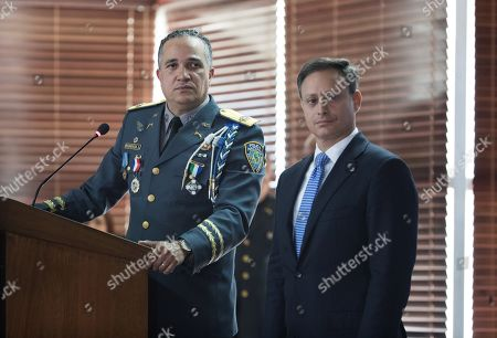 Stock Photo of Director of the Dominican National Police Ney Aldrin Bautista Almonte (L) and Attorney General of the Dominican Republic Jean Alain Rodriguez (R) deliver statements on the attack against former baseball player David Ortiz, in Santo Domingo, Dominican Republic, 12 June 2019. The former Boston Red Sox player David Ortiz was shot in the back on 09 June at the 'Dial Bar and Lounge' nightclub in the Dominican capital, when he was in the company of his press manager Jhoel Lopez, who was also wounded.