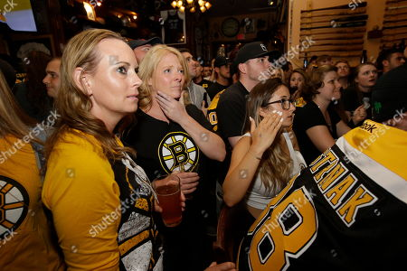 Stock Picture of Boston Bruins fans Amy O'Connor, of Dudley, Mass., center left, and Jennifer Lynch, of Auburn, Mass., behind center, react after the St. Louis Blues score a goal against the Bruins during the first period of Game 7 of the NHL hockey Stanley Cup Final, while watching the game on TV in a bar, in Boston. The Blues beat the Bruins 4-1 to win the Stanley Cup