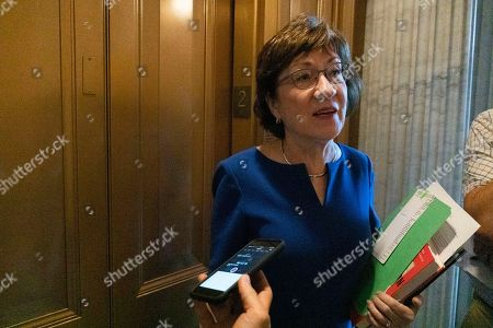 United States Senator Susan Collins (Republican of Maine) speaks to reporters after leaving the Senate floor
