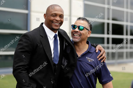 Former Tennessee Titans running back Eddie George, left, and former safety Blaine Bishop talk at the Titans' NFL football training facility, in Nashville, Tenn