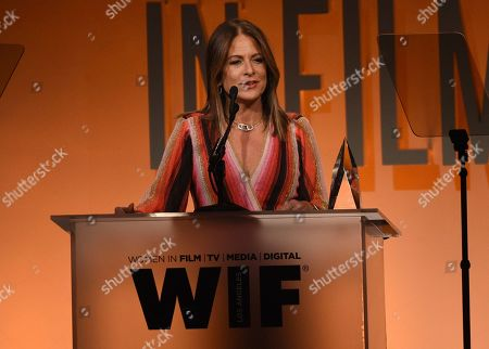 Cathy Schulman accepts the crystal award for advocacy in entertainment at the Women in Film Annual Gala, at the Beverly Hilton Hotel in Beverly Hills, Calif
