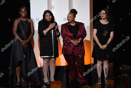 Hanelle M. Culpepper, Haifaa al-Mansour, Tina Mabry, Patricia Cardoso. ReFrame RISE beneficiaries Hanelle M. Culpepper, from left, Haifaa al-Mansour, Tina Mabry and Patricia Cardoso appear on stage at the Women in Film Annual Gala, at the Beverly Hilton Hotel in Beverly Hills, Calif