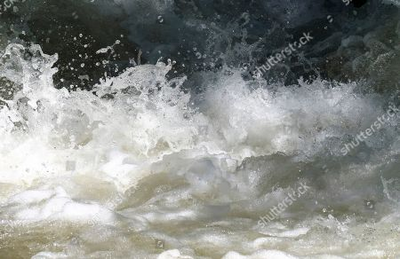 This, photo shows the raging waters in the Big Cottonwood Creek, near Salt Lake City. The summer's melting snowpack is creating rivers that are running high, fast and icy cold. The state's snowpack this winter was about 150 percent higher than the historical average and double the previous year, which was the driest on record dating back to 1874, said Brian McInerney, hydrologist for the National Weather Service in Salt Lake City. Large parts of the Salt Lake City metro area sits near the foothills of the towering Wasatch Range